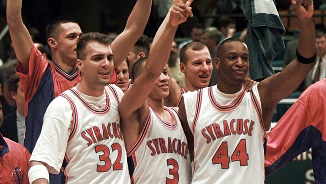 Syracuse players, from left, center J.B. Reafsnyder, guard Lazarus Sims, Prattsburgh's Marius Janulis and Greece Athena's John Wallace celebrate their 77-69 win over Mississippi State in their NCAA Final Four semifinal game on March 30, 1996, in East Rutherford, N.J.