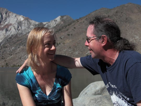 Kimberly and Patrick Wilkes, husband-and-wife guidebook team, shown in an engagement photo at Convict Lake in the Eastern Sierra.