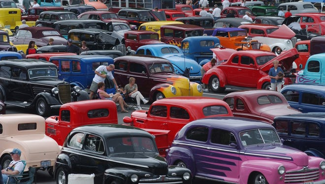 Spectators and particpants enjoy the warm weather while hanging out in the parking lot of Chilhowee Park during a previous year of the NSRA Street Rod Nationals South.