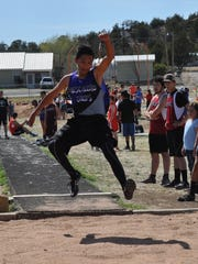 Mescalero's Sabastian Chino competes in the long jump at the Tiger Invitational.