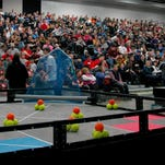 Elementary-age students compete in the Bank Shot game during the VEX IQ robotics competition last weekend at River's Edge Convention Center in St. Cloud.