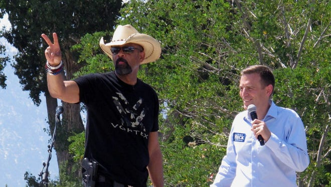 Milwaukee County Sheriff David A. Clarke Jr. (left) was introduced by Nevada Attorney General Adam Laxalt during a Republican rally and barbecue Aug. 20.