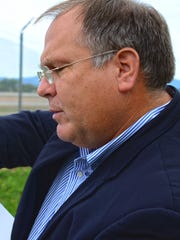 Burlington International AirportDirector of Aviation Gene Richards pointing to a map at Burlington International Airport on Friday, Sept. 30, 2016.