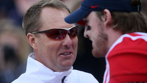Ole Miss head coach Hugh Freeze talks with quarterback Bo Wallace