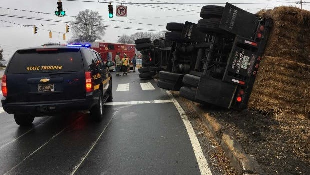 An overturned hay truck in Stanton Friday afternoon affected traffic.