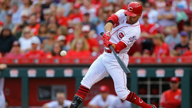 Aug 7, 2017; Cincinnati, OH, USA; Cincinnati Reds first baseman Joey Votto (19) hits an RBI single against the San Diego Padres in the first inning at Great American Ball Park. Mandatory Credit: Aaron Doster-USA TODAY Sports