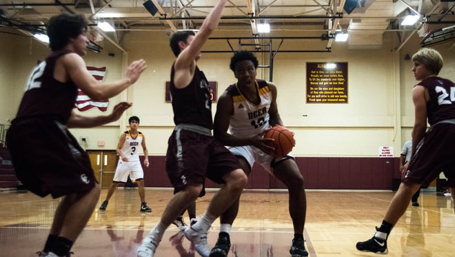Deer Park's Tristan Ikpe fights to the basket during the third quater of the Pride Of Texas Tournament Championship Game at Tuloso-Midway High School on Saturday, December 10, 2016. Clear Creek won the game 58-45 to earn the tournament championship.
