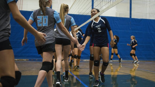 South Burlington and Burlington congratulate each other at the end of the girls volleyball game at Buck Hard Gym on Sept. 29.
