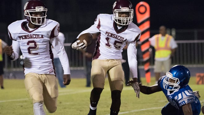 Pensacola High School's Tyrese Albritton, (No. 2) offers to block on the outside as Ernest Stallworth, (No. 15) gives the Washinton High School's Amari Severson (No. 44) the slip as during Friday night prep football.