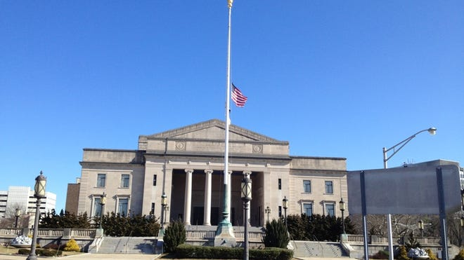 The American flag is flown at half staff at the Trenton War Memorial in February 2012. (File)