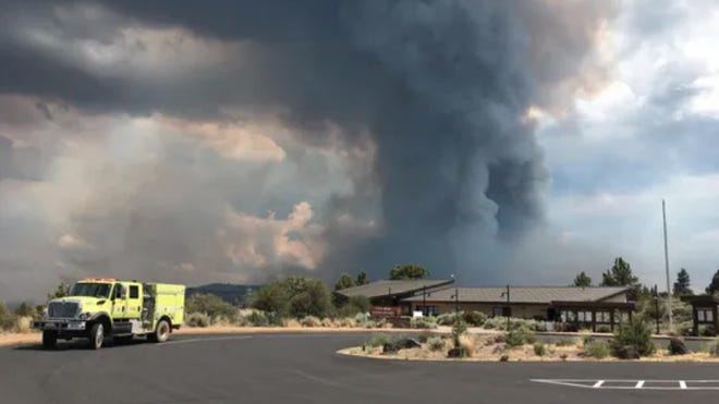 Lava Beds National Monument is closed due to the Caldwell Fire. A large plume of smoke rises behind the Lava Beds visitor center Thursday afternoon.
