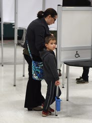 As Emily Elston votes at Northville's Moraine Elementary