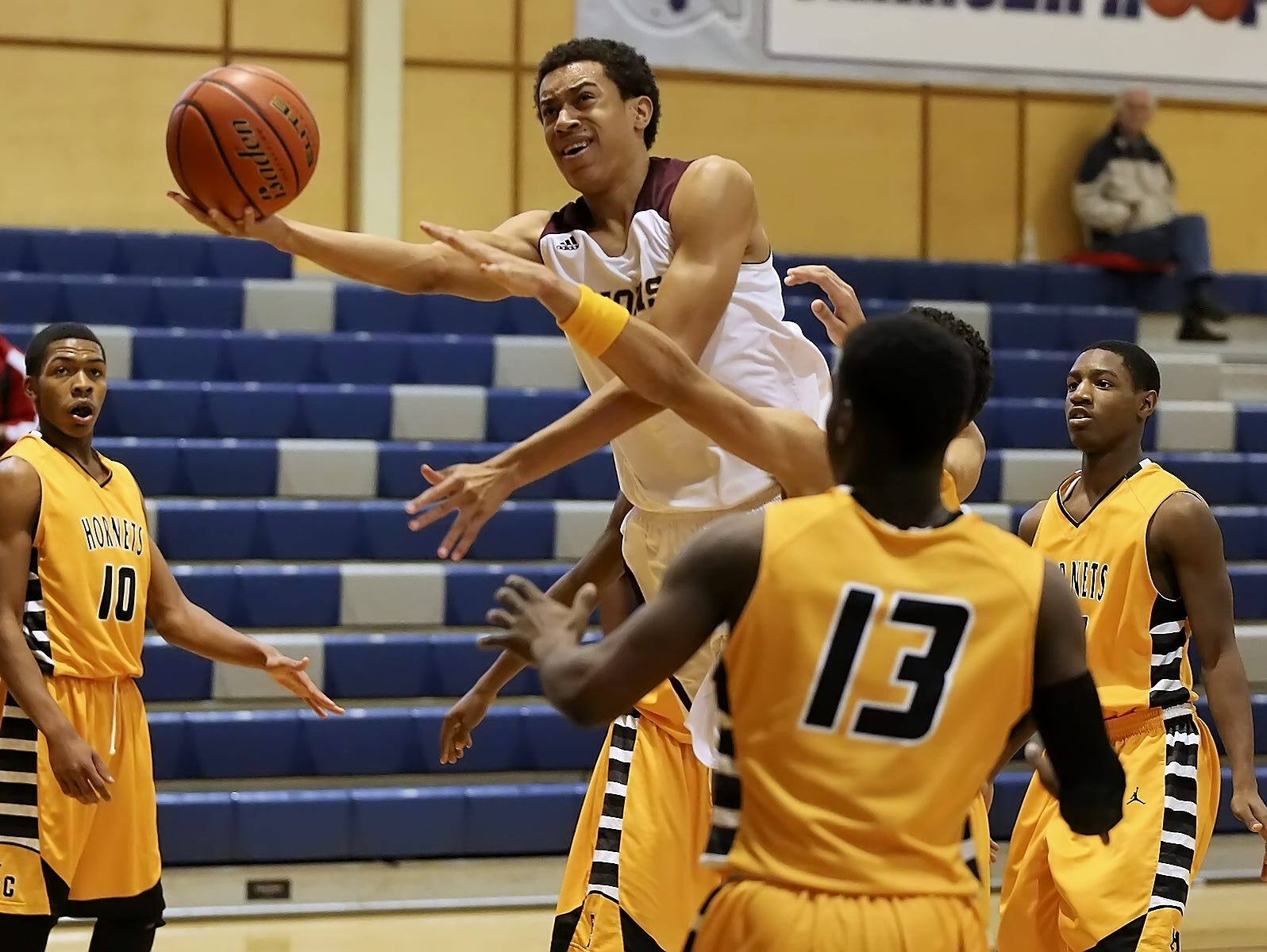 San Antonio Christian senior forward Justin Robinson, driving to the basket against East Central, will be a walk-on player at Duke next season.