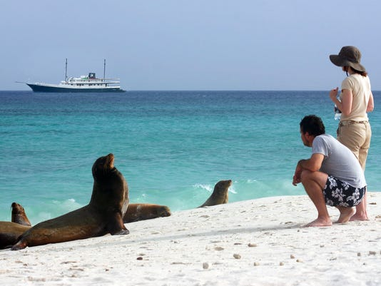635587309159863577-galapagos-guests-on-beach