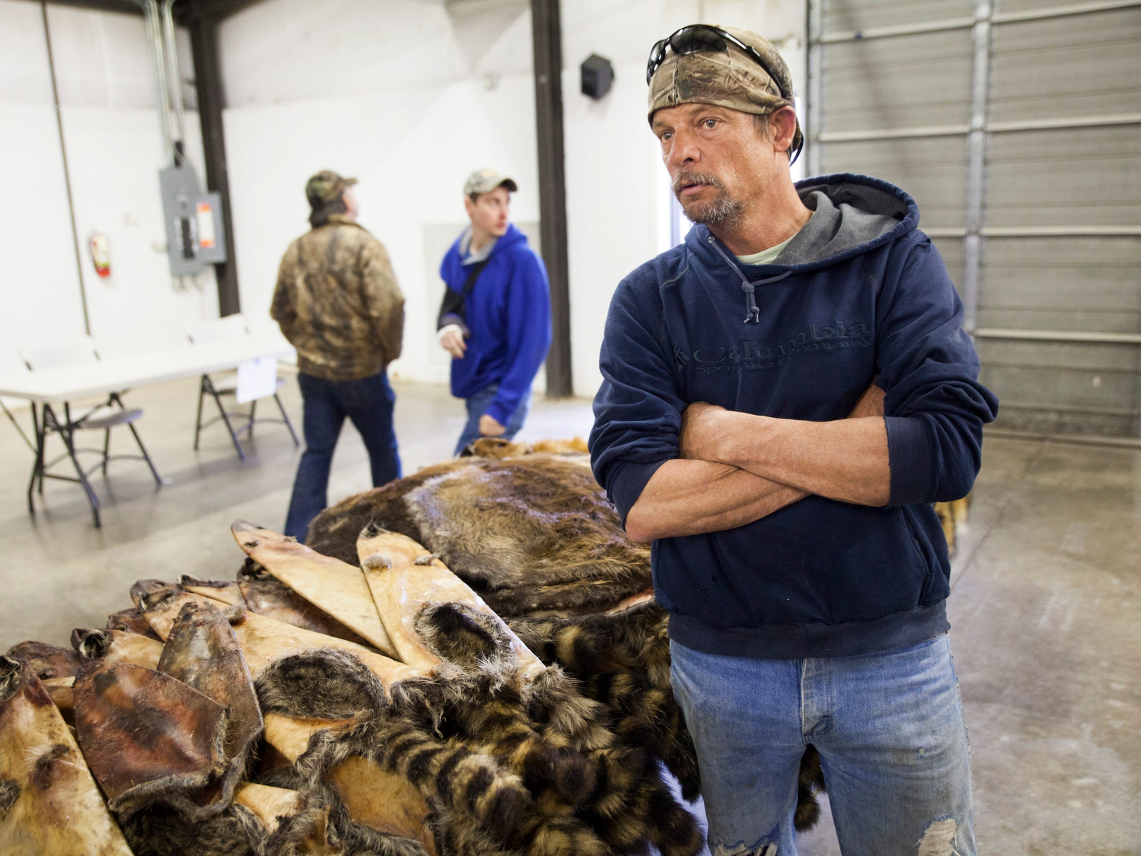 "Rick Golloday stands besides the furs he trapped to sell at the Virginia Trappers Association auction on Saturday, March 14, 2015. ""It's just been miserable this year for the fur price, I really don't know what happened to it,"" said Golloday, who has seen the value of his pelts fall in recent years."