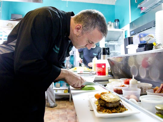 Chef and owner Doug Stehle works in the kitchen at