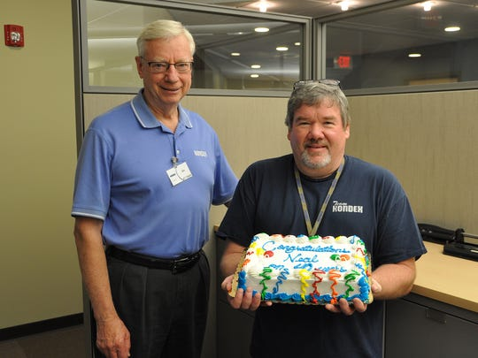 Kondex President Jim Wessing (left) congratulates Neal Stoffel on his 40th anniversary with Kondex.