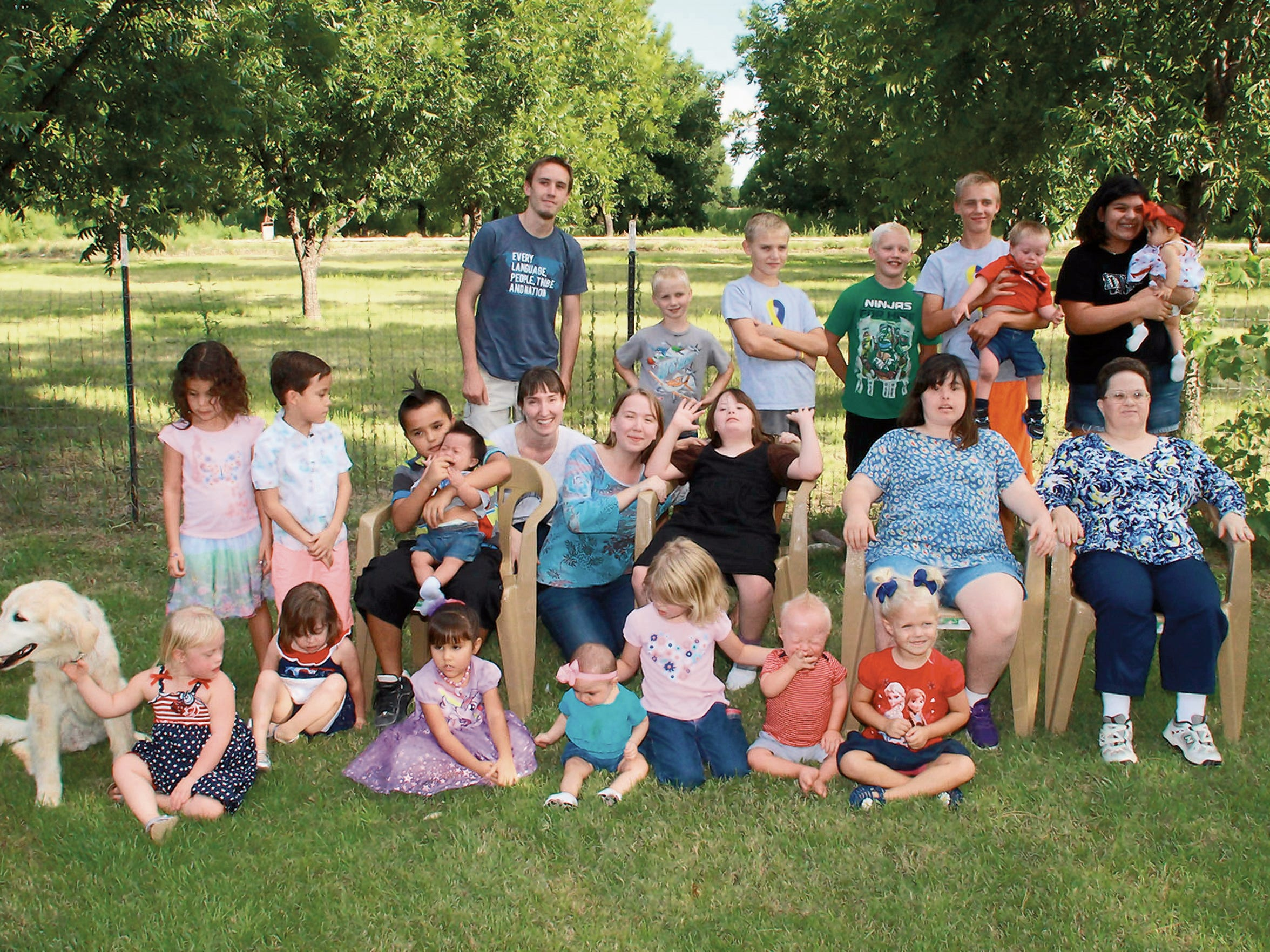 A group photo of people who attended a barbecue hosted by the nonprofit organization Down Syndrome Families of Las Cruces in July. Along with barbecues, the group  meets regularly for pot lucks, play dates, swimming lessons and other planned events that offer support and friendship for families who have children with Down syndrome.