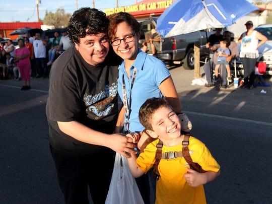 Rene, left to right, Yesenia, and Joaquin Legarreta.