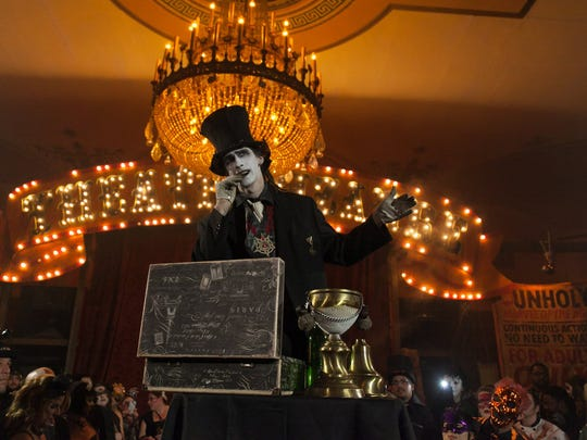 "Elaborate costumes were in order for guests, performers and staff during Theatre Bizarre's ""The Illusionists' Ball"" at the Masonic Temple in downtown Detroit on Saturday, Oct. 18, 2014."
