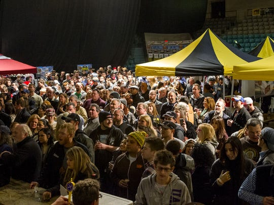 Asbury Park Beerfest guests (left) fill Convention Hall in Feburary 2015.