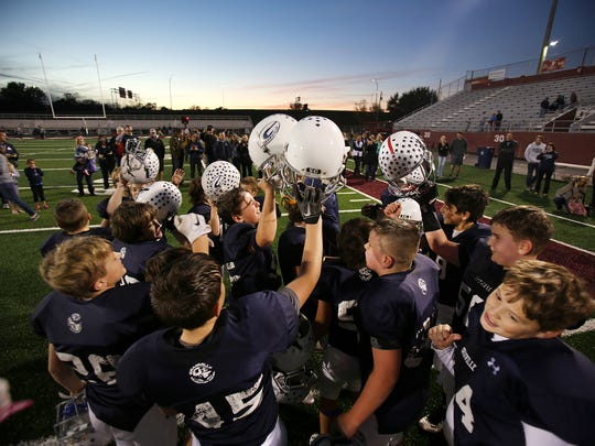 Granville Navy players celebrate their 29-6 victory against Heath Brown on Sunday in the Licking County League Youth Football Varner Division final at White Field.