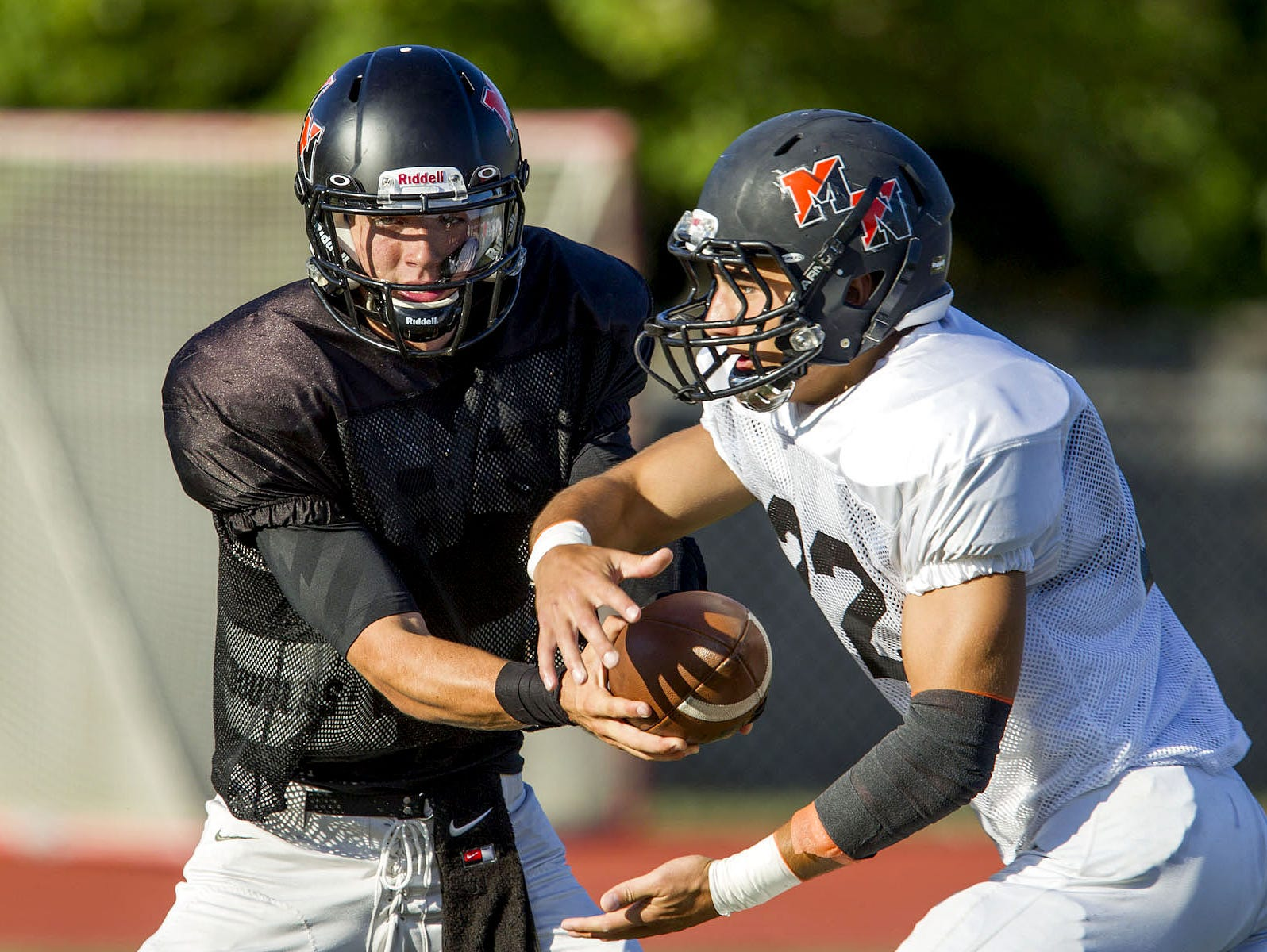 Middletown North, led by junior quarterback Donald Glenn (left) and senior running back Chad Freshnock (center)), will meet Middletown South Friday night in a NJSIAA North II Group IV semifinal