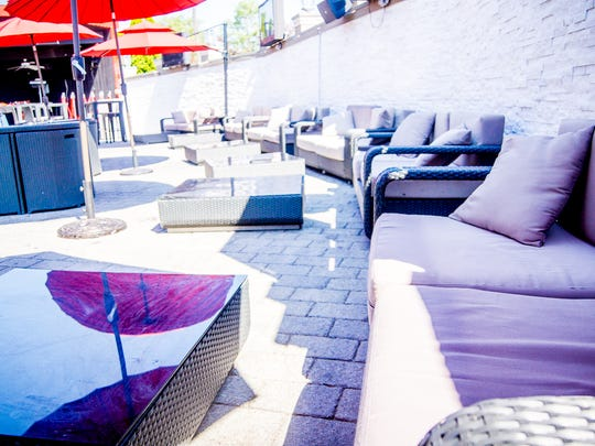 The patio area was redone to create a beach-like atmosphere.