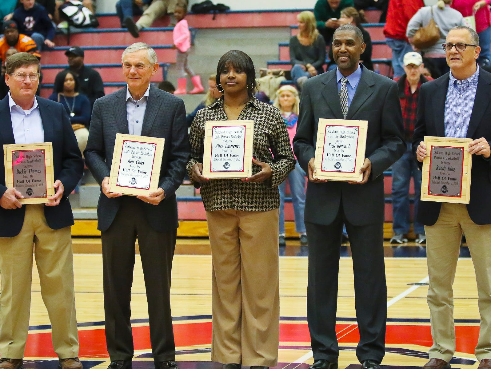 Oakland inducted its first basketball hall of fame class on Tuesday. From left, former boys coach Dickie Thomas, former girls coach Ben Cates, former girls standout Alice Lawrence, former boys standout Fred Batten Jr. and former boys coach Randy King were all inducted.