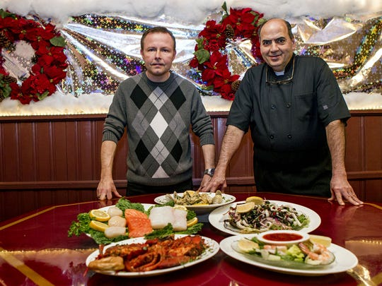 Joe Tuzzio (right), chef and owner of Tuzzio's Italian Cuisine in Long Branch, and manager Eddie Smentkowski will prepare a number of seafood dishes for takeout on Christmas Eve.
