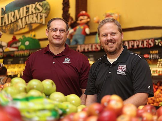 NMSU business marketing professors Collin Payne, right, and Mihai Niculescu.