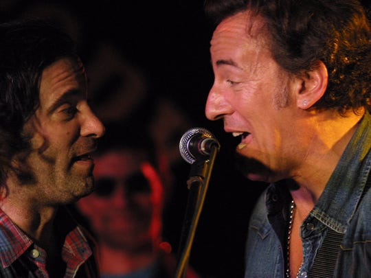 Bruce Springsteen and Bob Benjamin (left) on stage at the Stone Pony in 2004.