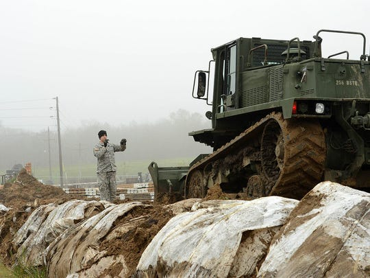 Louisiana National Guard Pvt. Taner Mansur of Walker, assigned to the 769th Brigade Engineer Battalion, 256th Infantry Brigade Combat Team, drivers a M105 Deployable Universal Combat Earthmover to repair a levee in Krotz Springs, La., in advance of expected river flooding, Jan. 8, 2016. The Louisiana National Guard has now mobilized more than 250 personnel in an effort to build protective barriers against the approaching flood waters and to patrol levees in support of local, parish and state officials at the request of the Governor's Office of Homeland Security and Emergency Preparedness.