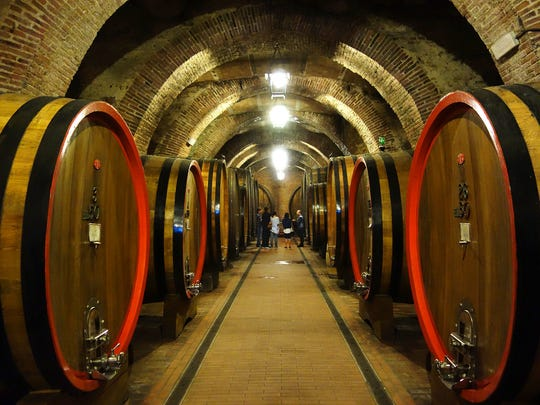 In Montepulciano, huge casks hold raw wine for at least