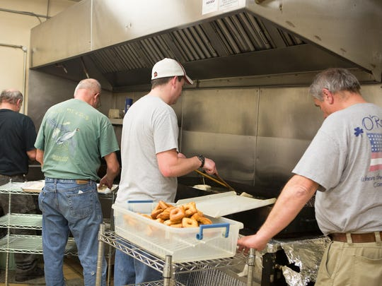 Fastnachts are fried at St. James Lutheran Church. The church sold over 1100 dozen fastnachts.