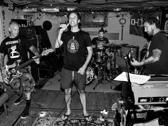 The Bouncing Souls are (from left) Bryan Kienlen, Greg Attonito, George Rebelo and Pete Steinkopf. The veteran punk band got its start playing house parties and basement shows in New Brunswick.