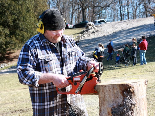 Sam Dougherty of Starving Carvist carved various wooden animals during Festivas Saturday afternoon