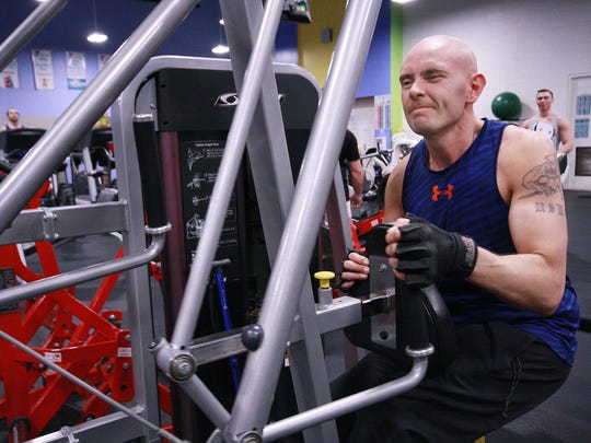 Scott Truran, a veteran with MS, works on his upper body strength at the Battle Creek YMCA.