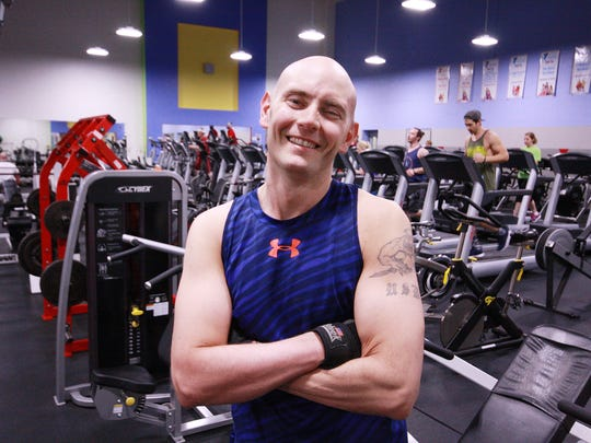Scott Truran, a veteran with MS, works on improving his strength at the Battle Creek YMCA.
