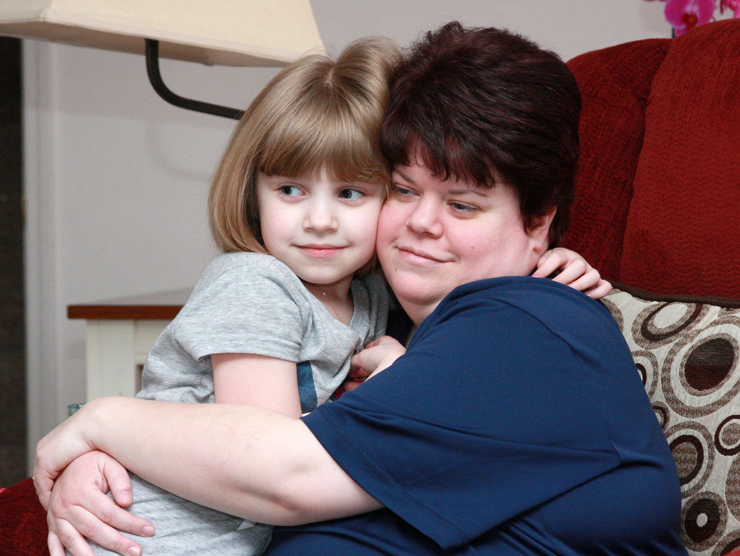 Juliana, 6, sits with her mother Vicki Wednesday evening.