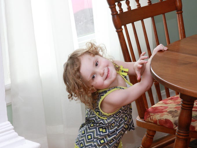 Alexsis Bryant poses in the dining room of her family's