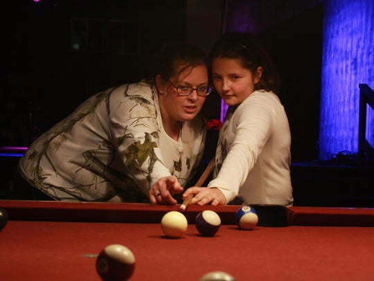 Gerrie Adkins teaches her daughter, Amber LaPorte,