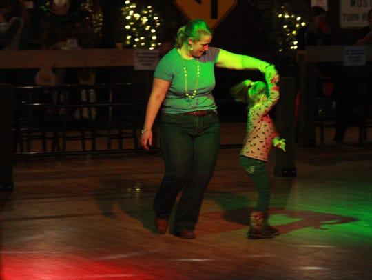 Amanda Shreve dances with her friend, Aubrey Flanders,