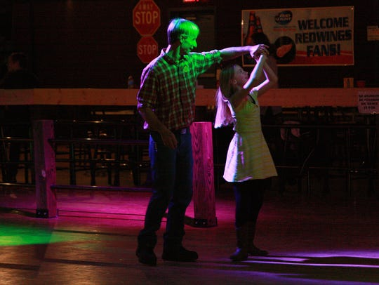 Markus Miller dances with daughter, Trinity, 9, during