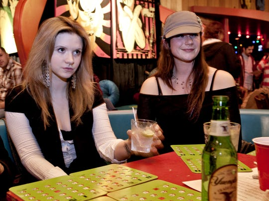 Kirsten Wright, left, and Jess Ronan, both of Asbury Park, play Sex Toy Bingo at Asbury Lanes.