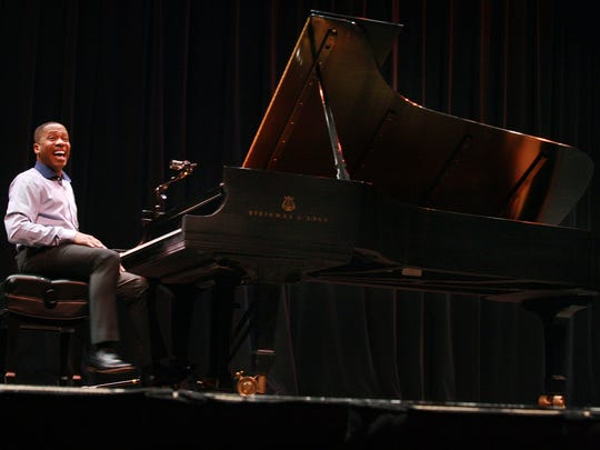 """Pianist, Terrence Wilson turns to the crowd of 1,700 students from Battle Creek elementary schools after playing the theme song of """"Super Mario"""" Wednesday morning at W. K. Kellogg Auditorium."""