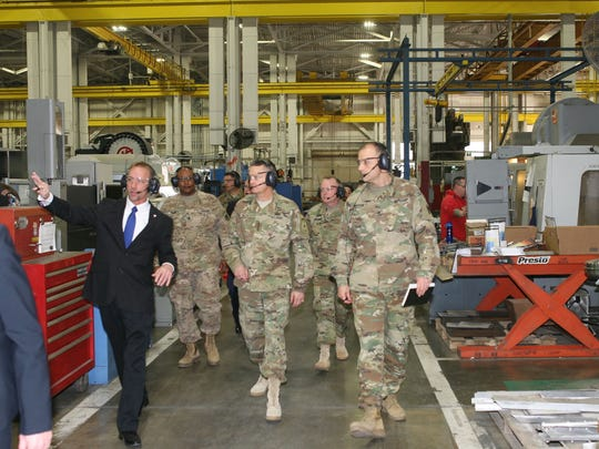 """The Ground Systems Readiness Facility at Letterkenny Army Depot was showcased as part of the Vice Chief of Staff Gen. Dan Allyn's visit to an """"organic industrial base"""" depot on March 24. The depot's Vertical Machine Center, a computer numerical controlled machine, is in the background."""