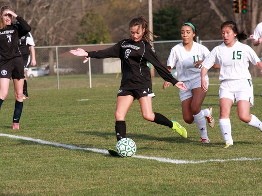 Lakeview's Maddee Long dribbles away from Pennfield