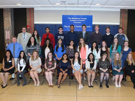 The Middlesex County Guidance Council presented Caring Awards to high school students at a dinner conducted at Middlesex County College in April. The Caring Award, given to one student from each high school in the county, is for outstanding volunteer community service. Seated, left to right: Modesty Miranda of Perth Amboy Vo-Tech; Rabeya Hussaini of Colonia High School; Alyssa Royce of Edison High School: Katrina McCarthy of Bishop George Ahr High School (Edison); Renu Nargund of East Brunswick High School; Abryanna Hernandez of Sayreville War Memorial; Harshini Malli of Monroe High School; Amber Rizzi of Old Bridge High School; Brooke Sutton of Wardlaw-Hartridge School (Edison); Eliana Hrizco of Highland Park High School. Middle row: Brandon A. Trapp of Piscataway Vo-Tech; Amber Camacho of Piscataway High School; Naome Nabi of South Plainfield High School; Thayna Horta of South River High School; Taslim Soomar of Middlesex Academy High School (Edison); Haley Carlton of Spotswood High School; Yossy Montecinos of Middlesex Borough High School; Isabella Guzzi of Dunellen High School; Dana Madden of South Brunswick High School; Amanda Fiore of JFK Memorial High School (Iselin). Top row: Dylan Johnson of East Brunswick Vo-Tech; Tara Lenahan of South Amboy High School; Akshat Mehta of J. P. Stevens High School (Edison); Frank DiNozzi of Carteret High School; Edward Diaz of New Brunswick High School; Tyler Soos of the Academy of Allied Health (Woodbridge); Alexander Brooks of Metuchen High School; Matthew Scull of St. Joseph's High School (Metuchen); Robert Bognar of Woodbridge High School. Not pictured: Rishil Patel of North Brunswick