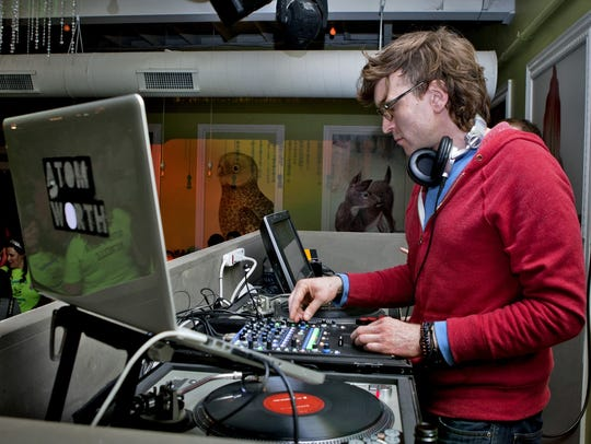 DJ Atom Worth spins the beats in the Abbott Room at